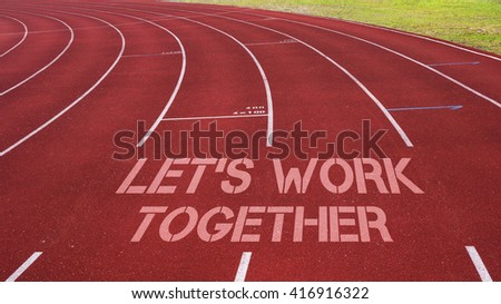 Motivational quote written on running track : Let's Work Together - stock photo