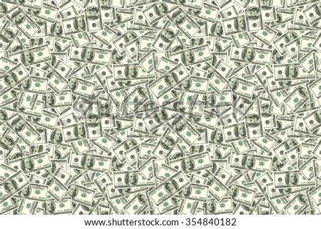 Motley background from chaotically scattered dollar banknotes abstract seamless geometrical patterns background. - stock photo