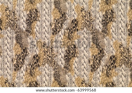 Motley textile with patterns of leopard and braids - stock photo