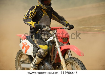 motocross bike in a race representing concept of speed and power in extreme man sport - stock photo