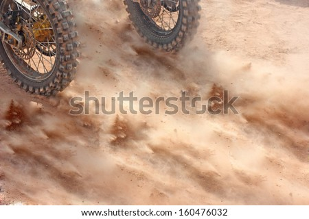 motocross bikes competition starting on the sand - stock photo