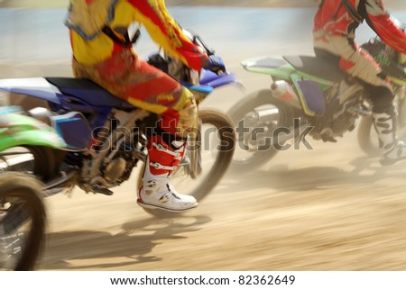 Motocross bikes racing in track - stock photo