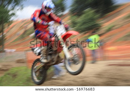 Motocross rider, abstract image created with intentional motion blur and zooming effect. - stock photo