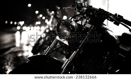 Motor bike headlight.Motorbike detail.Shiny chrome motorcycle.Closeup photo of motorcycle at night,active lifestyle,dangerous transport,journey and freedom concept.City traffic lights bokeh background - stock photo