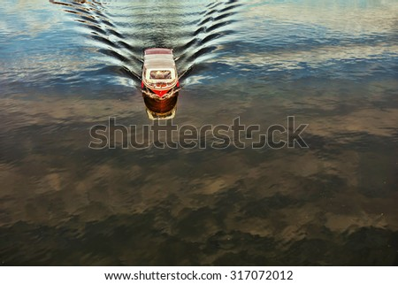 Motor Boat moving on the river. Water space with sky and clouds reflection. Beginning of journey  - stock photo