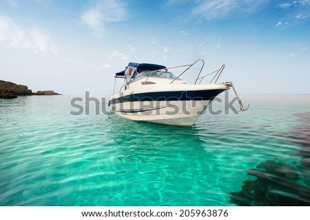Motor boat on the beach. - stock photo