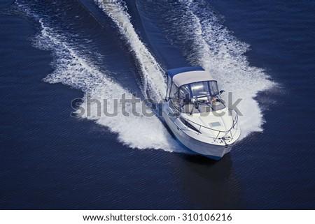 Motor boat sailing at high speed - stock photo