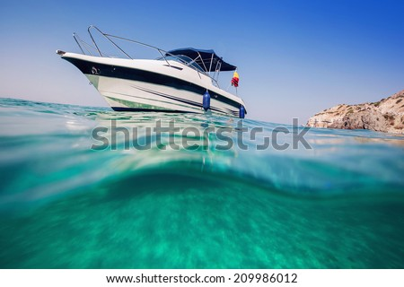Motor boat. View from under the water. - stock photo