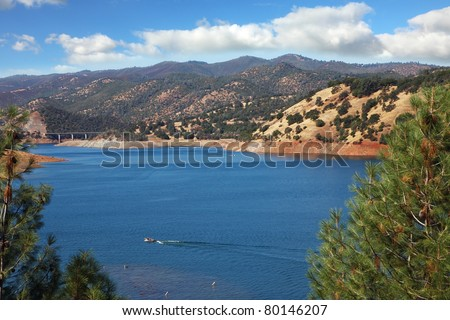 Motor boats at high speed sailing in the azure waters of the river Merced