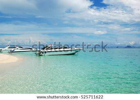 Motor boats on turquoise water of Indian Ocean, Phi Phi island, Thailand