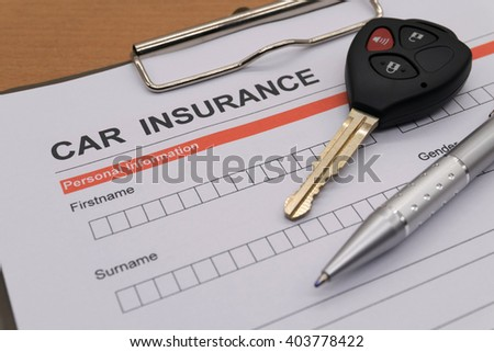 motor insurance with car key and pen - stock photo
