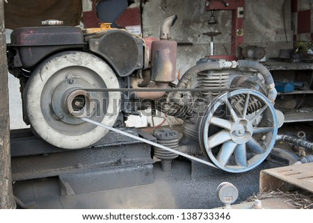 Motor of old air compressor - stock photo