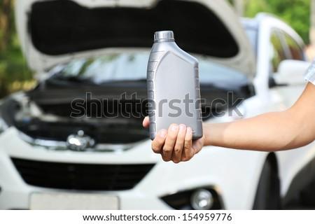 Motor oil in hand - stock photo