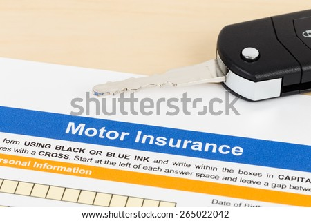 Motor or car insurance application with car key; document is mock-up - stock photo