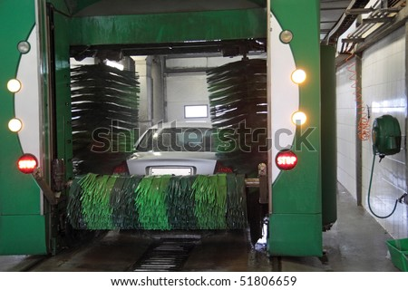 Motor vehicle on an automatic wash - stock photo