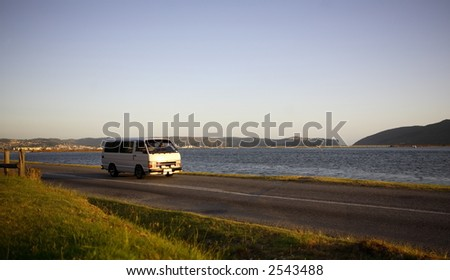 Motor vehicle travelling in the countryside - stock photo