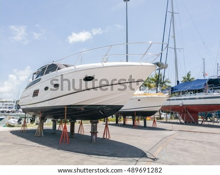 Motor yacht and Luxury yacht waiting for service and repair  in boat lagoon Marina