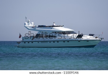 motor yacht floating on the ocean - saint-tropez, french riviera - stock photo
