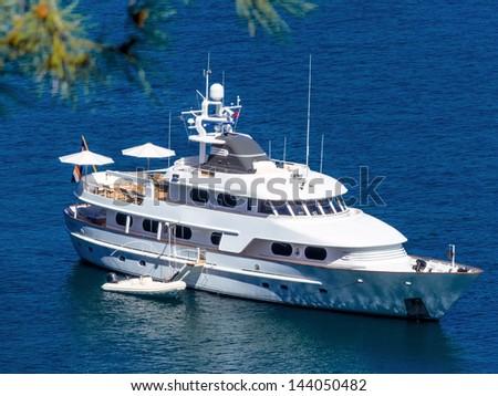 motor yacht on the sea, symbolic photo for luxury, leisure, vacation - stock photo
