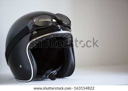 motorbike classic helmet with traditional glasses for protection. - stock photo