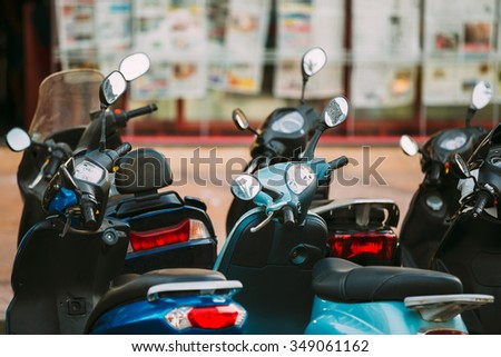 Motorbike, motorcycle scooters parked in city. - stock photo