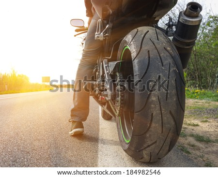 motorbike on the side of the street - stock photo