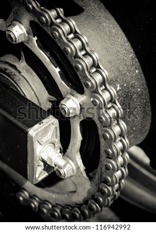 Motorbike or Motorcycle chain. Great for abstract background or poster. Selective focus on chain. Creative Lighting. - stock photo