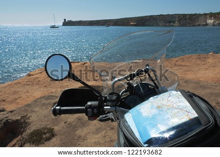Motorbike travel and adventure on the shore of Sardinia - stock photo