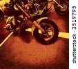 motorbikes in orange brown sienna color on asphalt to use as background or cd cover - stock photo