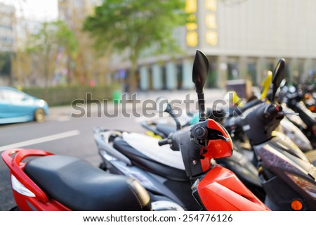 Motorbikes parked on the street of Macau. Macau is a popular tourist attraction of Asia and leading casino market of the world. - stock photo