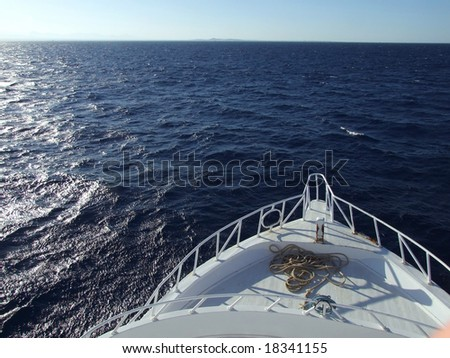 motorboat coming at sea, view of front - stock photo