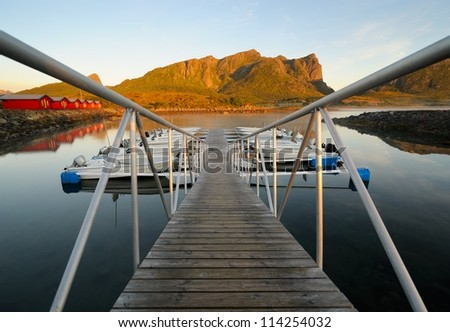 Motorboats moored on the fjord - stock photo