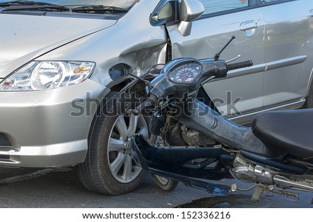 Motorcycle accident with a car. - stock photo