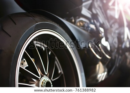 Motorcycle background with wheel and tire in the foreground
