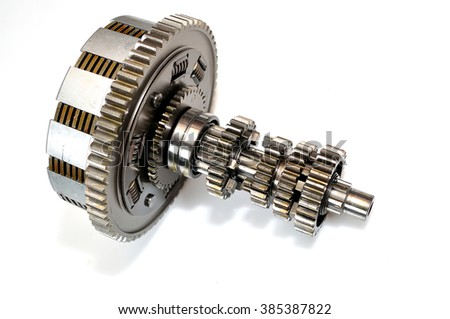 Motorcycle clutch gears isolated on white background. - stock photo