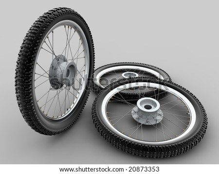 Motorcycle cross tyre on grey background