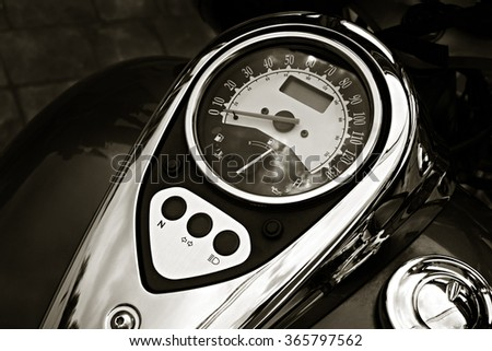 Motorcycle detail with gasoline tank and speedometer. Chrome motorcycle details closeup. - stock photo