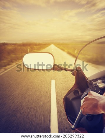 Motorcycle driving on highway - stock photo