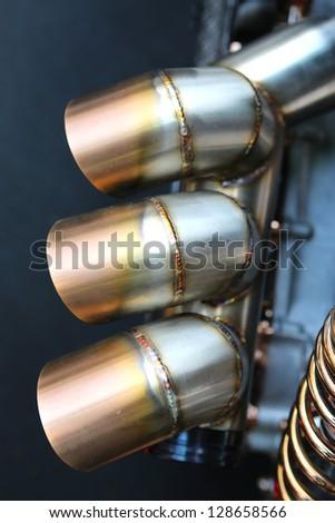motorcycle exhaust - stock photo