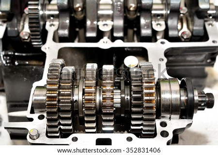 Motorcycle gear box with crankshaft behind.