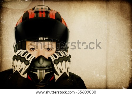 Motorcycle girl with helmet - Textured - stock photo