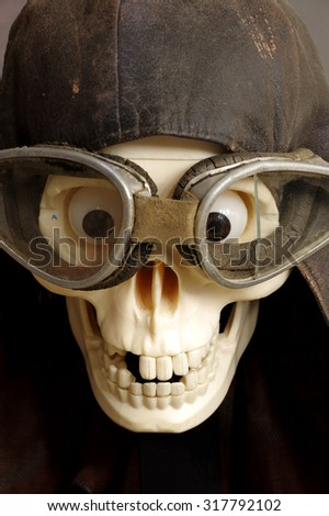 motorcycle goggles and helmet the skull - stock photo
