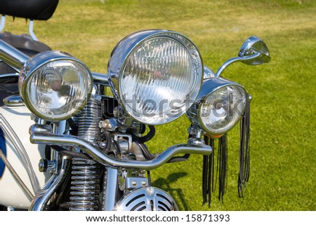 motorcycle  headlight, silver chrome, road transport - stock photo