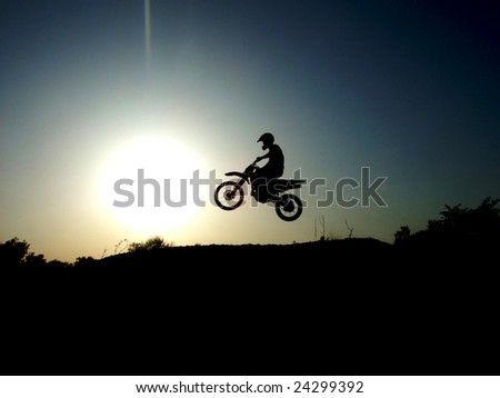 Motorcycle jump - stock photo