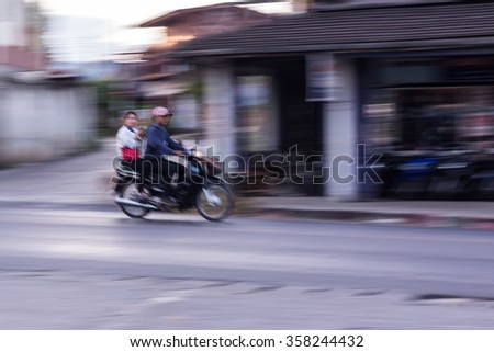motorcycle panning in road, Asia - stock photo