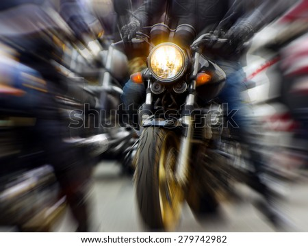 motorcycle rushing at city street, blurred motion - stock photo
