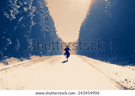 Motorcycling - Motorbike driver on a sunny winter day - stock photo