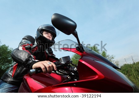 motorcyclist, bottom view - stock photo