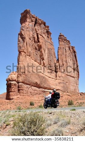Motorcyclist in Arches National Park - stock photo