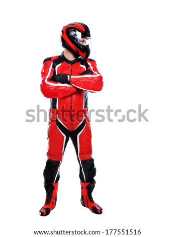motorcyclist in closed helmet looking to the side - stock photo